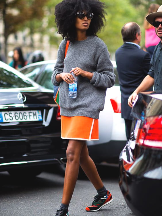orange-sporty-skirt-grey-sweater-layered-min