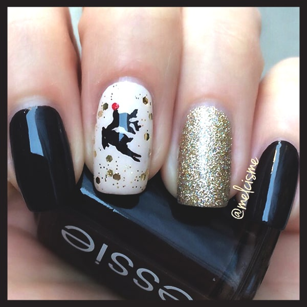 christmas-nail-art-design-ideas-black-and-gold-deer-nails-min