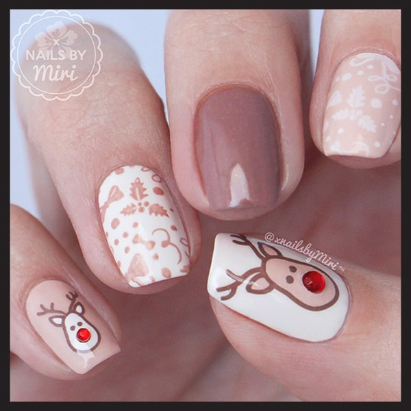 christmas-nail-art-design-ideas-nude-deer-christmas-nails-min