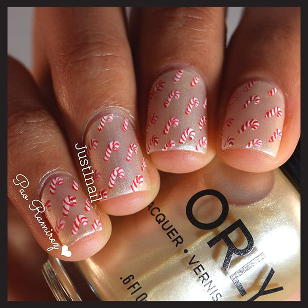 christmas-nail-art-ideas-gold-glitterand-little-candy-cane-nails-min