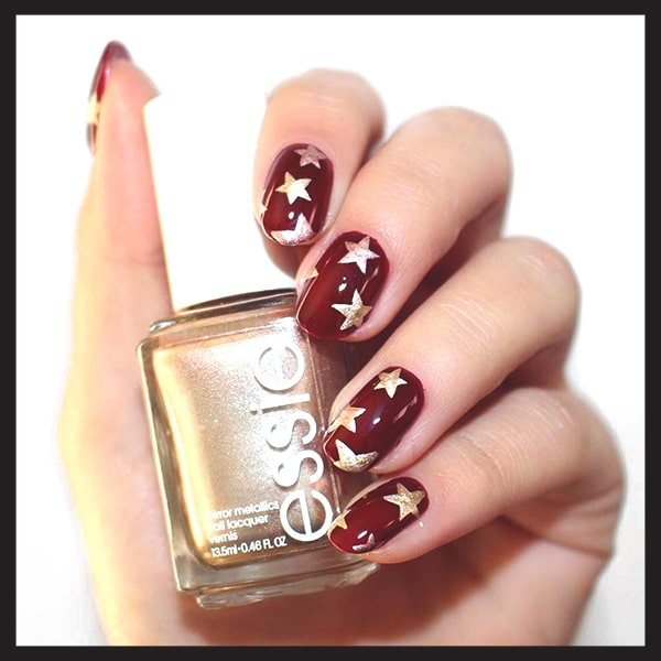 christmas-nail-art-ideas-red-and-gold-stars-nails-min