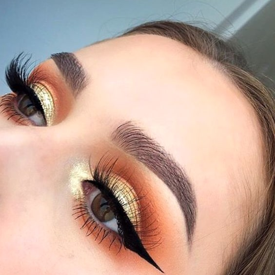gold-eyeshadow-black-liner-makeup-look-min
