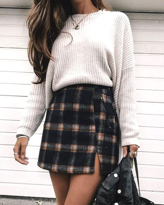 cozy-new-years-eve-outfit-ideas-check-skirt-white-sweater-min