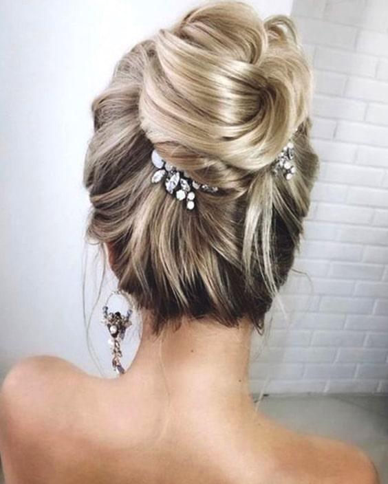 elegant-high-bun-wedding-hair-min