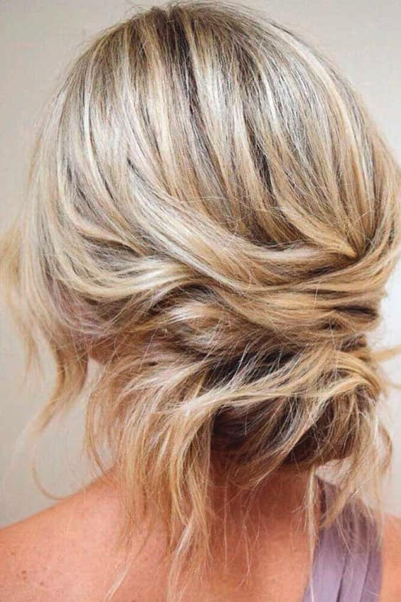 hairstyles-for-medium-length-hair-blonde-messy-bun-min