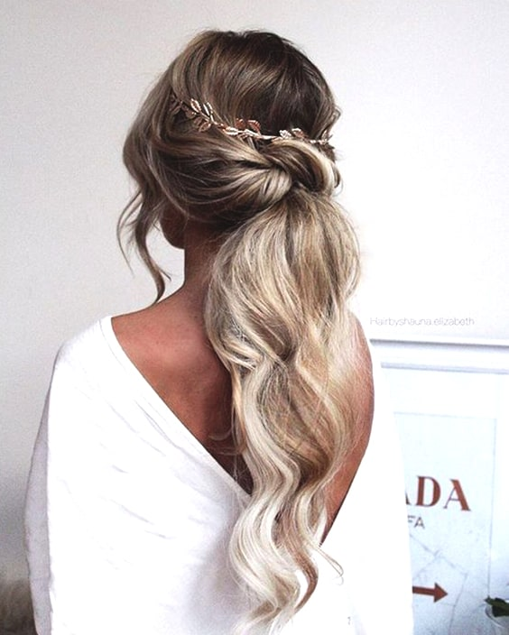 low-textured-pony-wedding-hairstyles-min