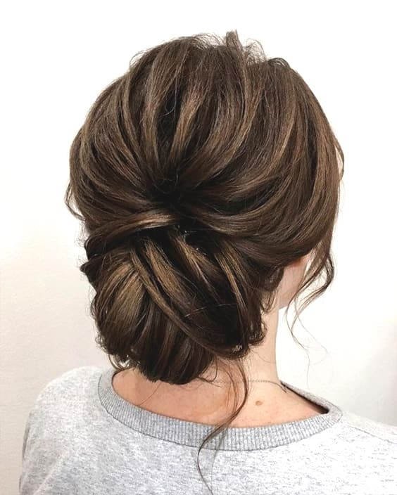 messy-brunette-low-updo-wedding-hairstyle-min
