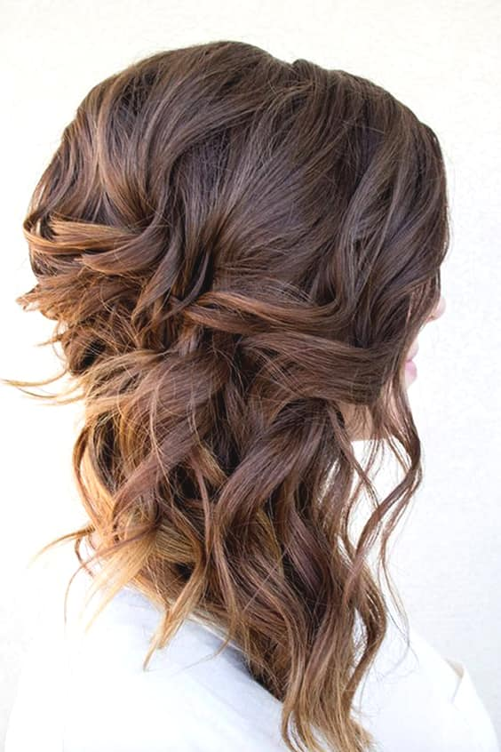 side-swept-curls-wedding-hairstyles-min