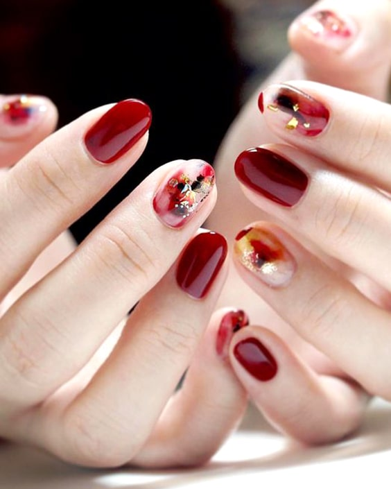 valentines-day-burgundy-abstract-nail-design-min